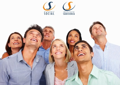 Group of multi racial business people looking up at copyspace