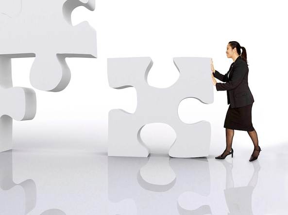 asian business woman building a puzzle over a white background